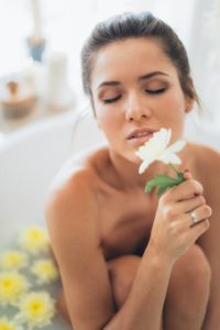 afterbath-woman-holding-flower